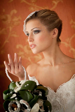 Portrait of Beautiful Fancy Bride with Bouquet photo