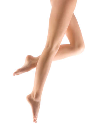 Woman Legs at the White Background .
