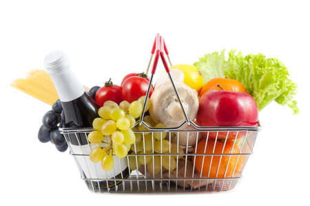 Shopping Concept: Perfect Shopping Cart Filled with Red Wine, Champignons, Mushrooms, Grapes, Spaghetti, Cherry Tomatoes, Apples, Lemons, Oranges, Green Salad on White Background