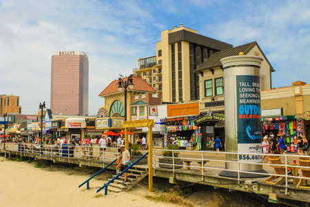ATLANTIC CITY, NEW JERSEY - June 23, 2013 - Boardwalk with Ballys Hotel and Casino