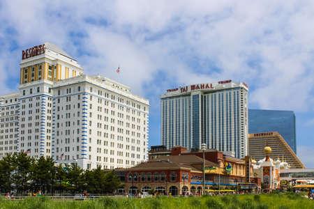 showboat: ATLANTIC CITY, NEW JERSEY - June 23, 2013 - Boardwalk with Trump Taj Mahal Resort and Resorts Hotel