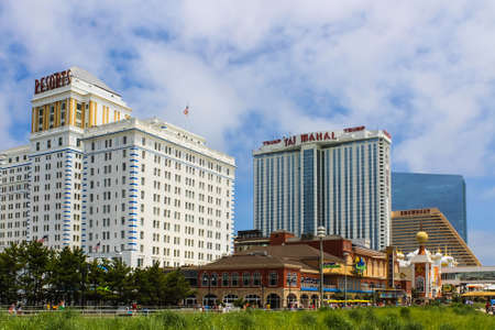 ATLANTIC CITY, NEW JERSEY - June 23, 2013 - Boardwalk with Trump Taj Mahal Resort and Resorts Hotel