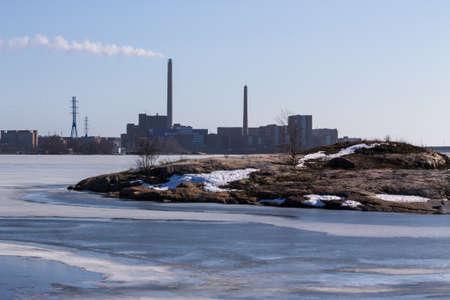 industrial landscape: Paesaggio industriale su una riva dell'oceano rocciosa