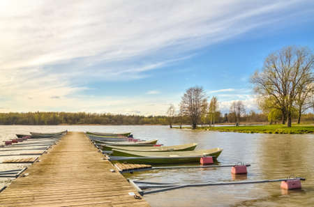 rowboats: Rowboats tied to a wooden pier in a small harbor