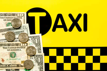 fare: Taxi fare concept - Money on the black and yellow background