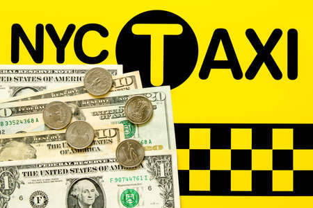 fare: NYC Taxi fare concept - Dollar bills and coins on the black and yellow background Stock Photo
