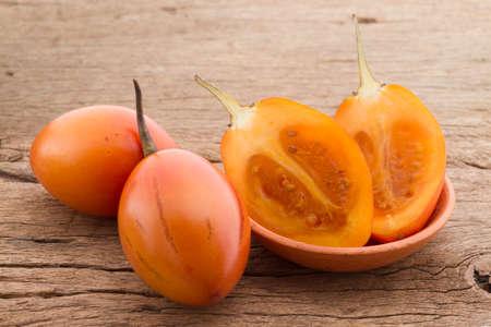 tree tomato fruits on the table (Solanum betaceum) Banco de Imagens