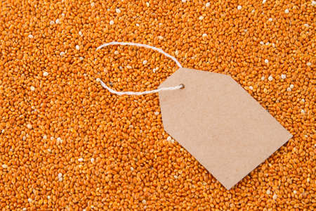 paper tag on red millet.