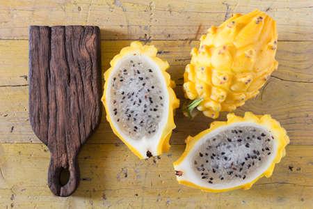 yellow pitahaya dragon fruit on wooden background