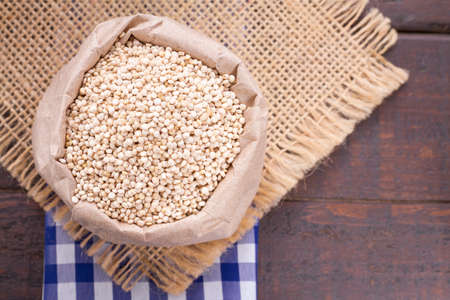 quinoa beans in bowl on the table. Stock Photo