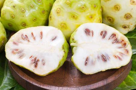 Noni fruits on the table, Morinda citrifolia. Stok Fotoğraf