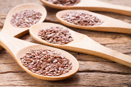 flax seed grains on the table, Linum usitatissimum Zdjęcie Seryjne