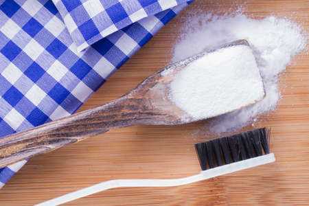 baking soda and brush are the wooden table. Stockfoto