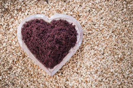 Acai powder in bowl on wooden background Stock Photo
