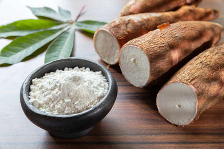 Raw yucca starch on the wooden table - Manihot esculenta.. Stock Photo