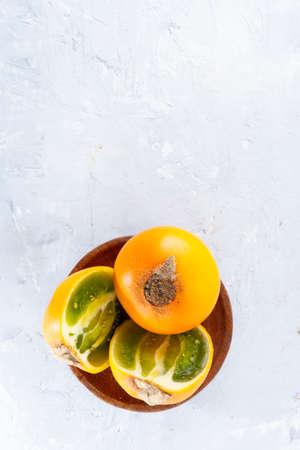 lulo fruit on white background (Solanum quitoense)