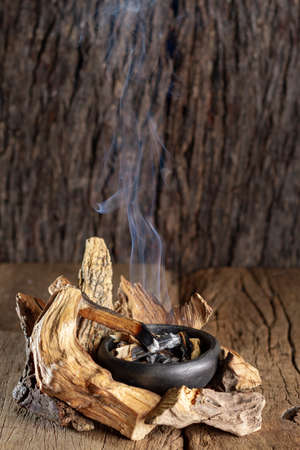 Sacred wood palo santo - Bursera graveolens,on rustic wood background
