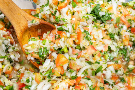 pico de gallo dressing, typical food of Colombia - close-up image