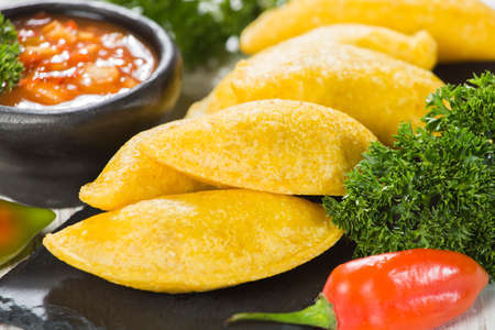 Empanadas with hot sauce, traditional Colombian food