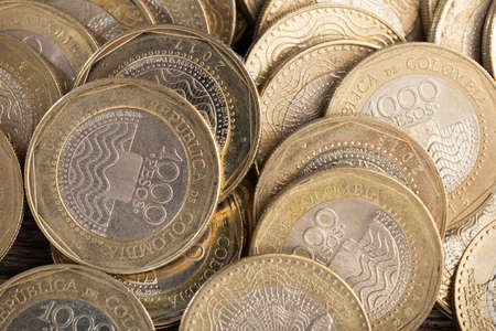 pile of Colombian peso coins, close-up image Archivio Fotografico