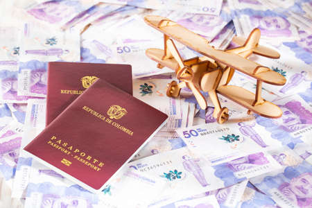 Colombian passport on Colombian money, close-up image Stock Photo
