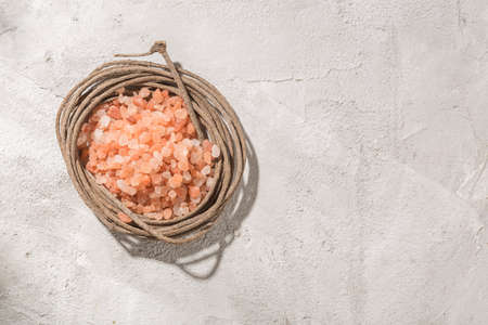 pink himalayan salt, in bowl on white background