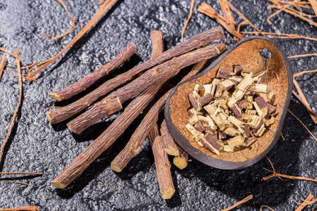 licorice stalks, medicinal plant on black background