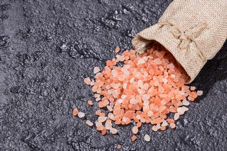 pink himalayan salt, in bowl on black background