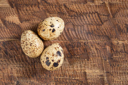 Quail eggs, on the wooden table, close-up image