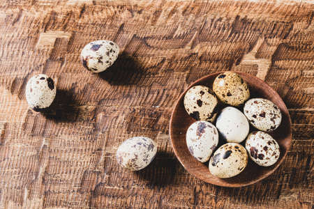 Quail eggs, on the wooden table, close-up image Stock fotó