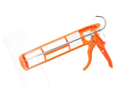 orange caulking tool, isolated on white background, space for text