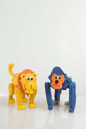 monkey and toy lion, on white background, close up image Stock fotó