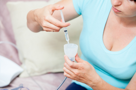 orgasm: A woman fills a capacity for inhalation of medicine