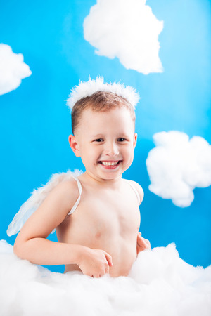 boy Cupid sitting on a cloud with an arrow in hand