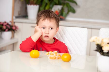 brooding: Brooding boy cleans tangerines
