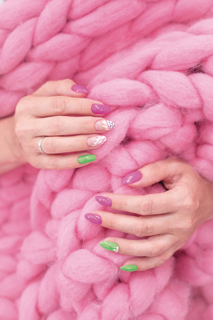 lots of color gloss manicure hands has different blotches in pink background Standard-Bild