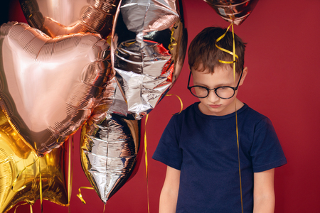a hurt child is one with balloons upset the holiday disrupted