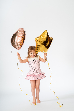 baby with heart shaped balloons and stars on white background 写真素材 - 121349881