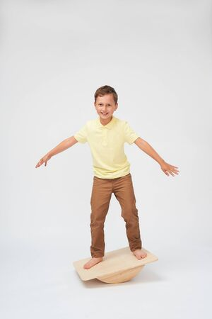baby boy stands on a special simulator for training the vestibular apparatus. to keep the balance standing on the treadmill. training of the vestibular apparatus.balance exercise balancing