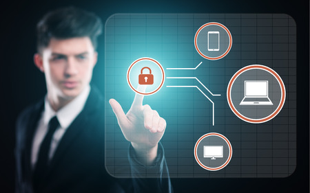 cyber defence: business, technology, internet concept. businessman pressing button on virtual screens