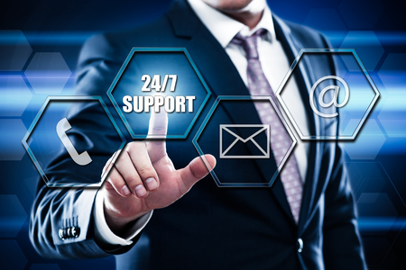 Business, technology, internet concept on hexagons and transparent honeycomb background. Businessman pressing button on touch screen interface and select 24 7 support Banque d'images