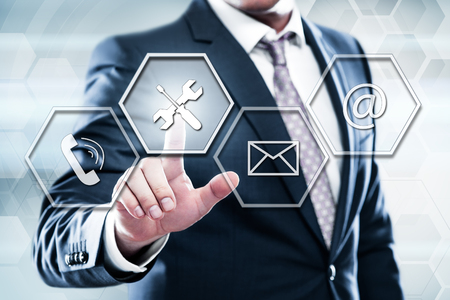 Business, technology, internet concept on hexagons and transparent honeycomb background. Businessman pressing button on touch screen interface and select technical support
