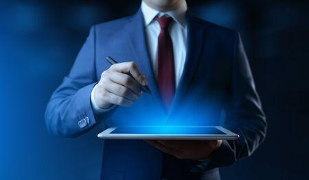 Businessman holding digital tablet. Man using gadget in office