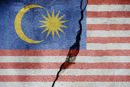 Malaysia   FLAG PAINTED ON CRACKED WALL Stock Photo