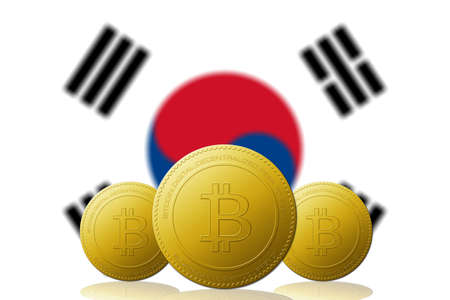 Three Bitcoins cryptocurrency with South Korea flag on background.