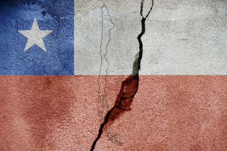 Chile earthquake tragedy flag painted on cracked wall.