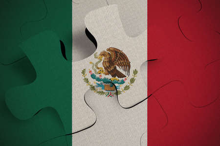 Composition of the concept of crisis and integration of a country Mexico FLAG PAINTED ON PUZZLE 3D RENDER Foto de archivo