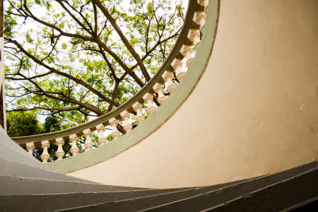 Interesting point of view of a staircase with leafy trees around it. Stock fotó