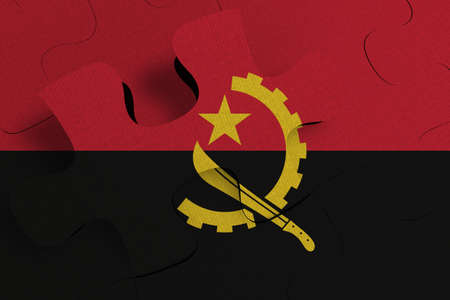 Composition of the concept of crisis and integration of a country   Angola   FLAG PAINTED ON PUZZLE 3D RENDER 版權商用圖片