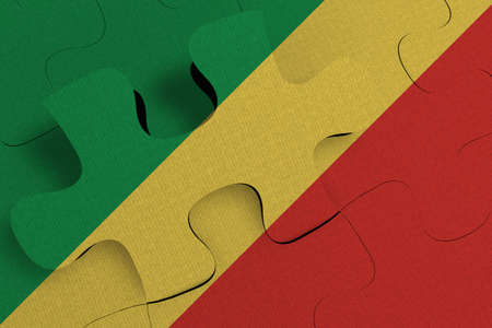 Composition of the concept of crisis and integration of a country   Republic of the Congo   FLAG PAINTED ON PUZZLE 3D RENDER 版權商用圖片